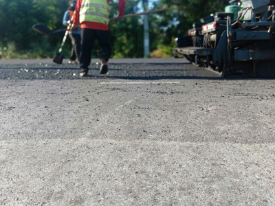 Asphalt work being completed on a very hot day