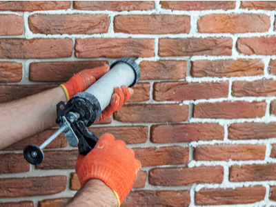 Brick work being completed by an employee